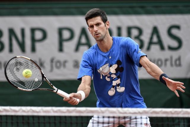 Novak Djokovic assure qu'il ne doit pas faire... (AFP, Philippe Lopez)