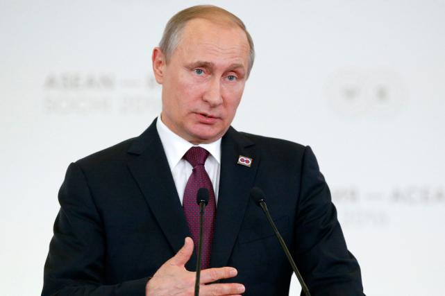 Le président russe Vladimir Poutine... (Alexander Zemlianichenko, AP)
