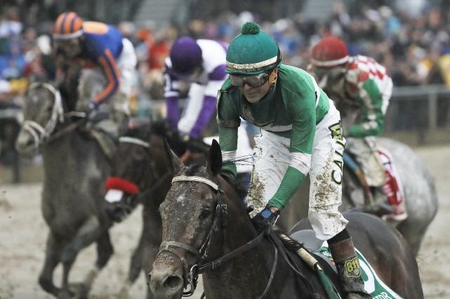 Le jockey Kent Desormeaux et Exaggerator ont battu... (AP, Matt Slocum)