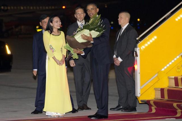 Barack Obama lors de son arrivée à l'aéroport... (Carolyn Kaster)