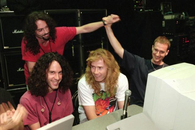 Nick Menza (au fond à gauche), en 1997,... (Photo archives AP)