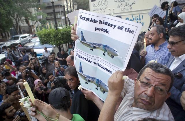 Une vigile a été organisée mardi au Caire,... (AP, Amr Nabil)