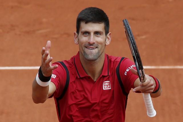 Novak Djokovic a franchi le deuxième tourdes Internationaux... (AP, Michel Euler)
