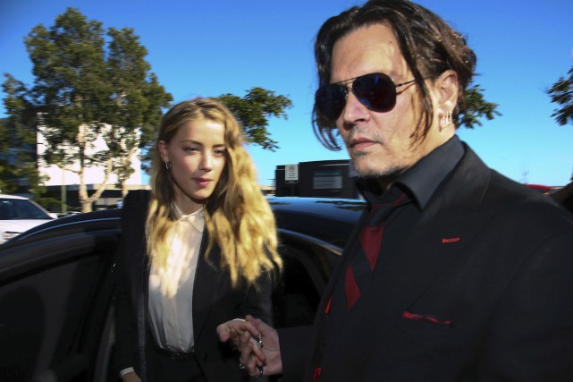 Amber Heard et Johnny Depp... (Photo Patrick Hamilton, Agence France-Presse)