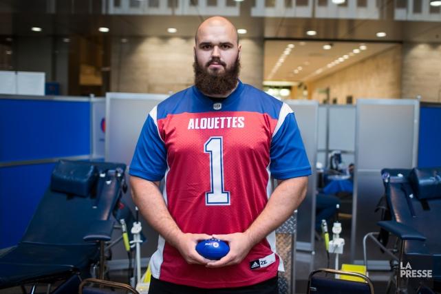Le joueur de ligne offensive du Rouge et... (Photo Olivier PontBriand, La Presse)