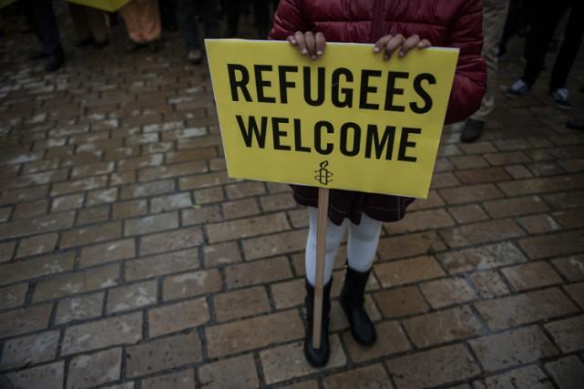 L'Espagne s'était engagée à accueillir plus de 17... (PHOTO AP)