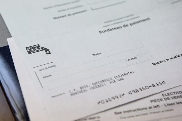 Au Québec, l'impôt sur le revenu des particuliers... (PHOTO HUGO-SÉBASTIEN AUBERT, ARCHIVES LA PRESSE)