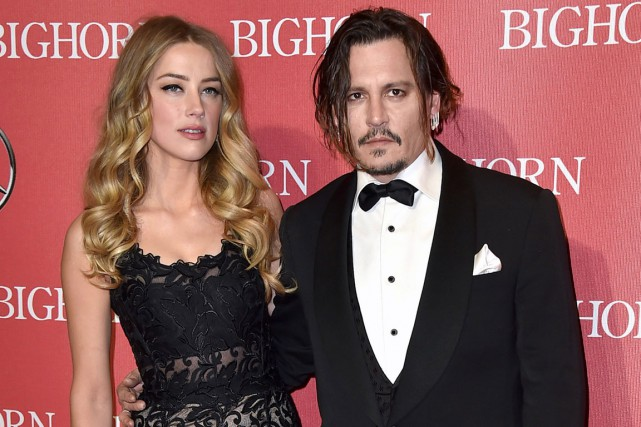Amber Heard et Johnny Depp le 2 janvier... (PHOTO JORDAN STRAUSS, INVISION, AP)