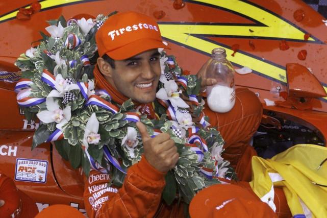 Champion en titre des 500milles d'Indianapolis qui seront... (Archives AP, Michael Conroy)