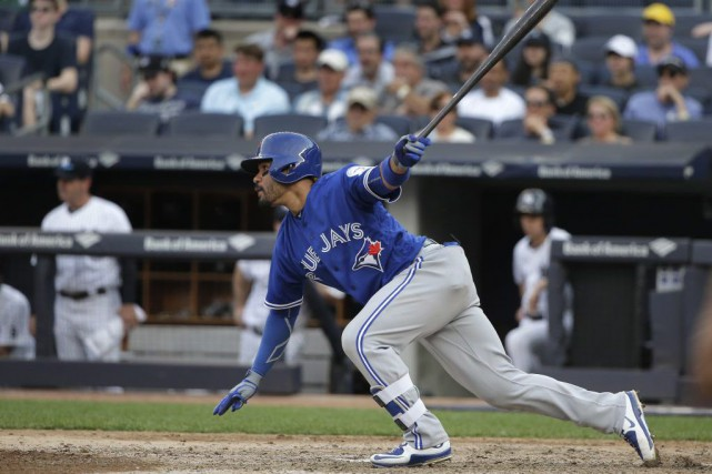 Devon Travis a frappé un simple contre Aroldis... (Julie Jacobson, AP)