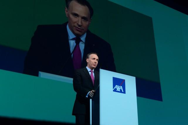Le nouveau patron d'AXA, Thomas Buberl, doit entrer... (PHOTO ERIC PIERMONT, ARCHIVES AFP)