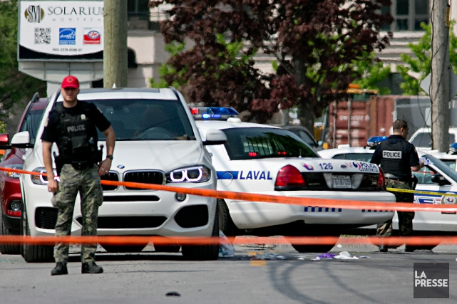 Le crime s'est déroulésur le boulevard Saint-Elzéar Ouest... (PHOTO DAVID BOILY, LA PRESSE)