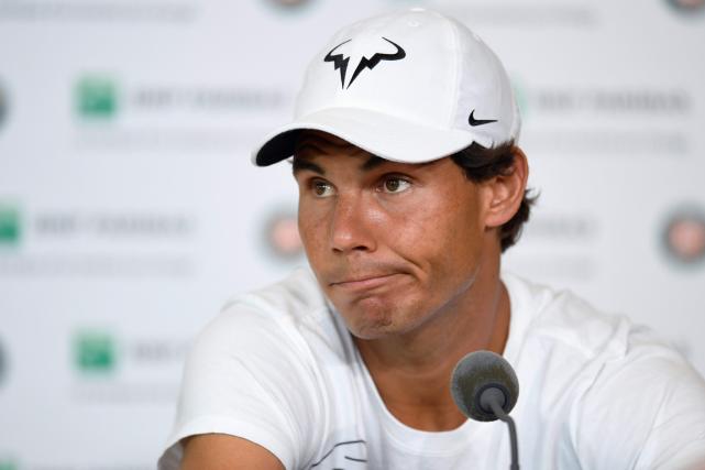 Rafael Nadal souffred'une blessure au poignet gauche.... (Photo Miguel Medina, AFP)