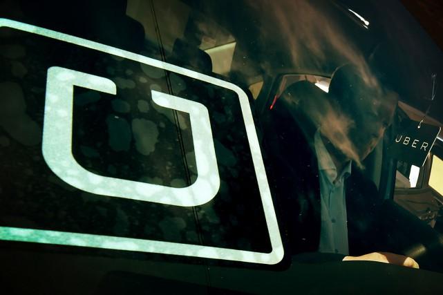 Leprojet de loi 100 forcerait Uber à acquérir... (ARCHIVES AFP)