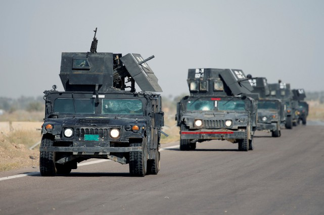 Un convoi de Humvee de la branche antiterroriste... (Photo Thaier Al-Sudani, Reuters)