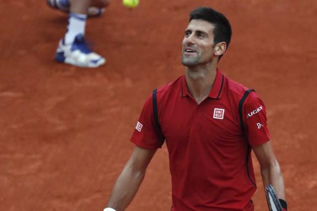 Le Serbe Novak Djokovic s'est assuré de ne pas devoir retourner sur le terrain... (Photo AFP)