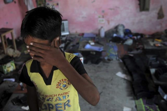 Sur cette photo tirée des archives, un jeune... (Agence France-Presse, Manan Vatsyayana)