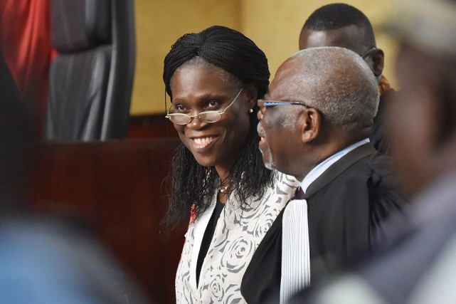 Simone Gbagbo arborait un grand sourire à son... (PHOTO  ISSOUF SANOGO, AFP)