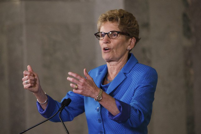 La première ministre Wynne affirme que les lois... (Codie McLachlan, Archives PC)