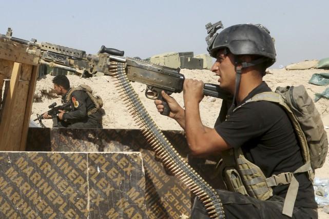 Au 10e jour de leur offensive, les forces... (PHOTO AP)