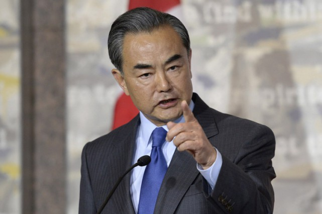 Wang Yi répond à une question d'un journaliste... (PHOTO PC)