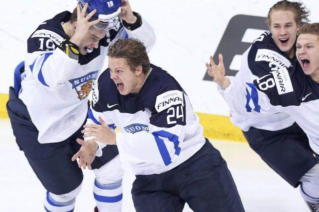 Les joueurs finlandais ont explosé de joie lorsque... (AFP, Markku Ulander)
