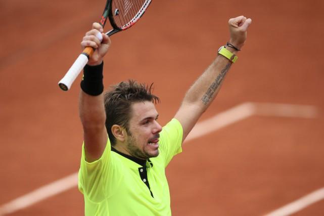 Le champion en titre de Roland-Garros Stanislas Wawrinkaa... (David Vincent, AP)