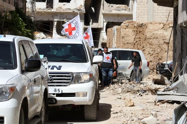 Un convoi humanitaire est entré mercredi à Daraya,... (Photo Fadi Dirani, AFP)