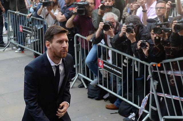 La vedette du FC Barcelone, Lionel Messi (sur... (Josep Lago, AFP)
