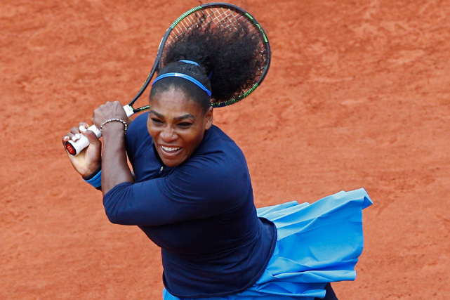 Serena Williams n'est plus qu'à une victoire du record... (Photo Christophe Ena, AP)