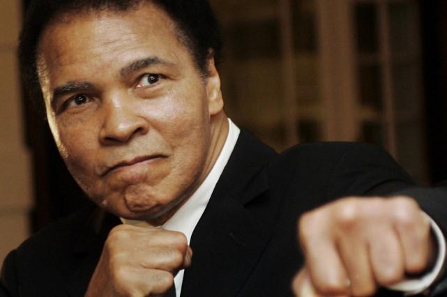 Les problèmes respiratoires du boxeur sont aggravés par... (Photo archives Reuters)