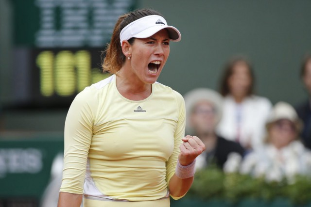 Garbine Muguruza... (PHOTO ALASTAIR GRANT, AP)