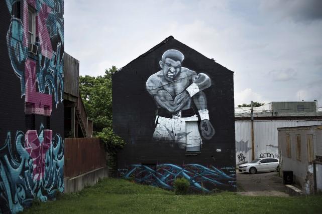 Une murale représentant Ali à Louisville, au Kentucky.... (Agence France-Presse)