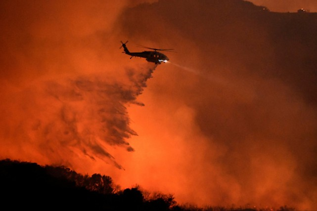 Une grande partie des 5000 personnes évacuées avaient... (PHOTO REUTERS)