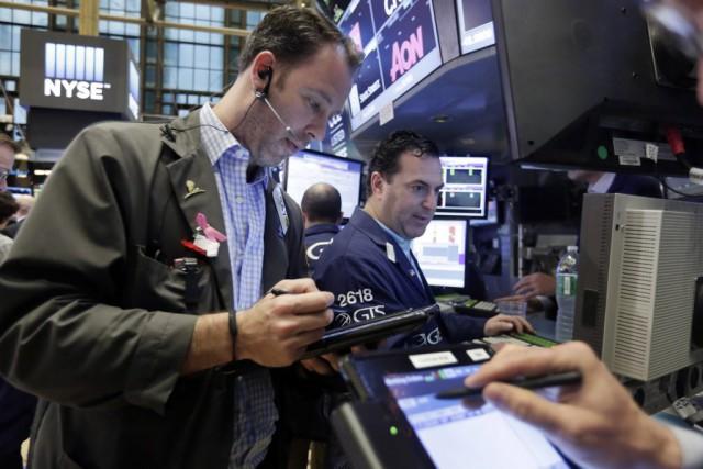Wall Street a fini en hausse tranquille lundi, rassurée par la prudence de la... (Photo Richard Drew, AP)