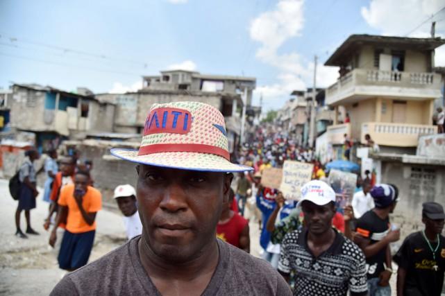 Des partisans du parti Fanmi Lavalas manifestent à... (PHOTO  HECTOR RETAMAL, ARCHIVES AFP)