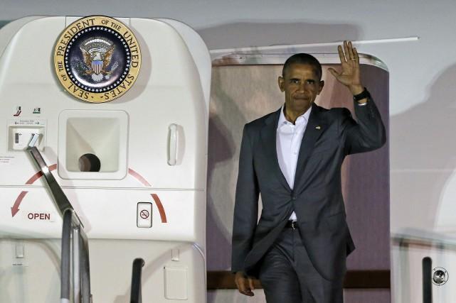 Le président Obama a observé une relative neutralité... (Photo AP)