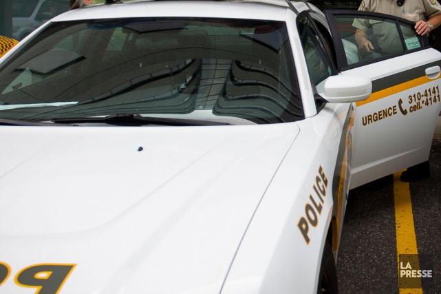 Les policiers de la SQ et leurs collègues de la GRC ont procédé, mercredi, à... (Archives La Presse)