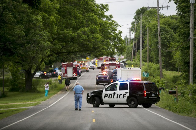 Les policiers avaient été informés quelques minutes plus... (PHOTO Chelsea Purgahn, Kalamazoo Gazette-MLive Media Group/AP)