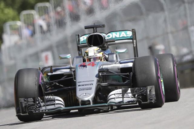 Lewis Hamilton a signé un chrono d'une minute... (Tom Boland, La Presse Canadienne)