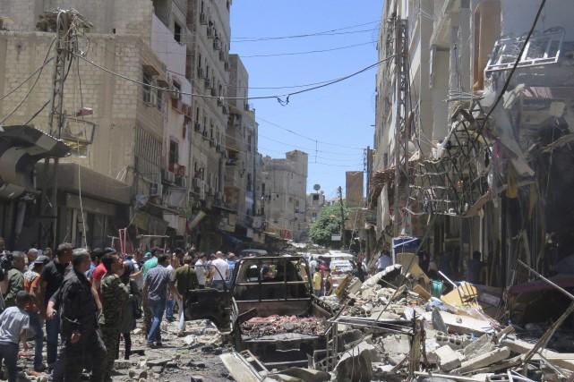 Le groupe armé État islamique a revendiqué samedi... (AFP/Stringer)