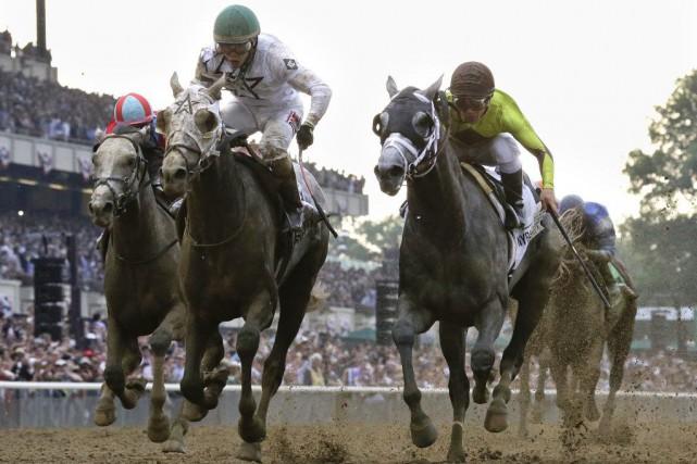 Creator, à gauche, avait terminé 13e au Derby... (PHOTO Julio Cortez, AP)