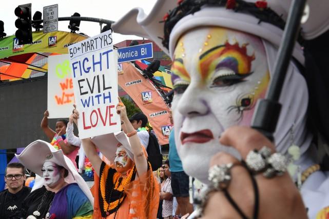 Des participants ont rendu hommage aux victimes de... (Photo Mark Ralston, AFP)