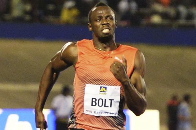 Bolt s'est dit «chagriné» à l'idée de devoir... (AP, Collin Reid)