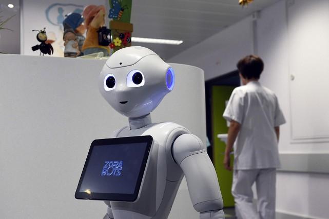 Des robots de la génération de Pepper ont... (PHOTO JOHN THYS, AFP)
