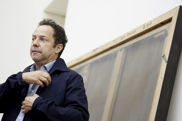 L'artiste brésilien Vik Muniz lors de l'ouverture de... (Agence France-Presse, Martijn Beekman)