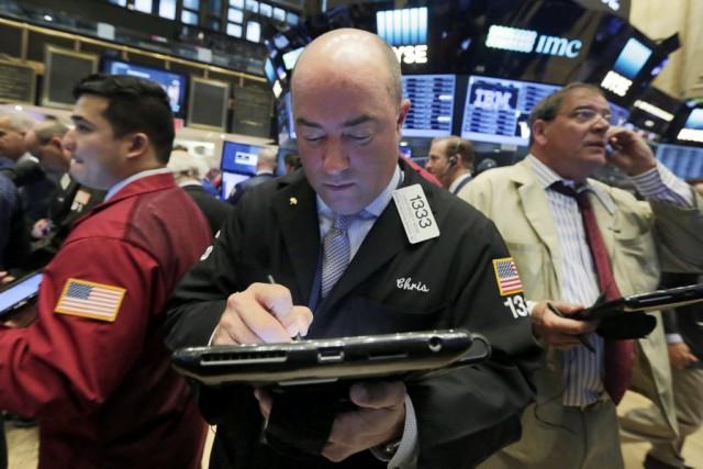 Les marchés boursiers nord-américains ont terminé la séance jeudi sur une note... (Photo Richard Drew, AP)