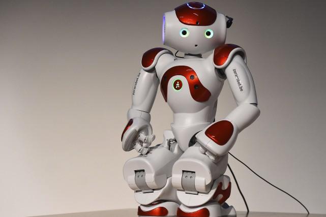 Un robot présenté à la foire du tourisme... (Agence France-Presse, Tobias Schwarz)