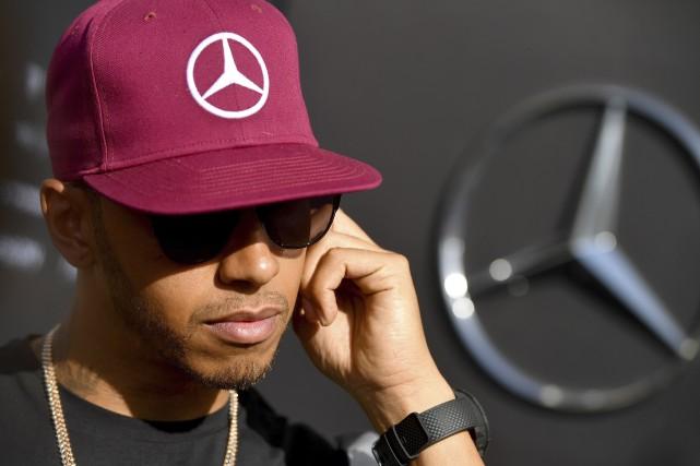 Lewis Hamilton vise une victoire incontestable lors du... (AFP, ANDREJ ISAKOVIC)