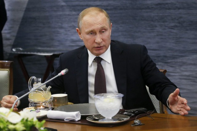 Vladimir Poutine... (PHOTO Dmitry Lovetsky, AP)